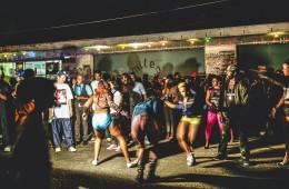 """Kingston, Jamaica - June 26, 2008: Crowd enjoying reggae/dancehall music and dancing at ghetto street party, called """"Passa Passa"""", Tivoli Gardens."""